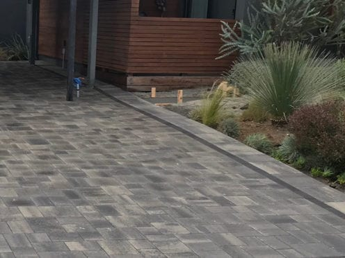 Angelus Courtyard Pavers Driveway with a Double Border