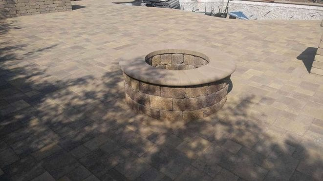 Courtyard Pavers with Circular Fire Pit with Sand Bullnose