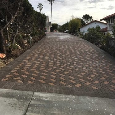 Cream and Brown Holland Paver Driveway in Herringbone Pattern