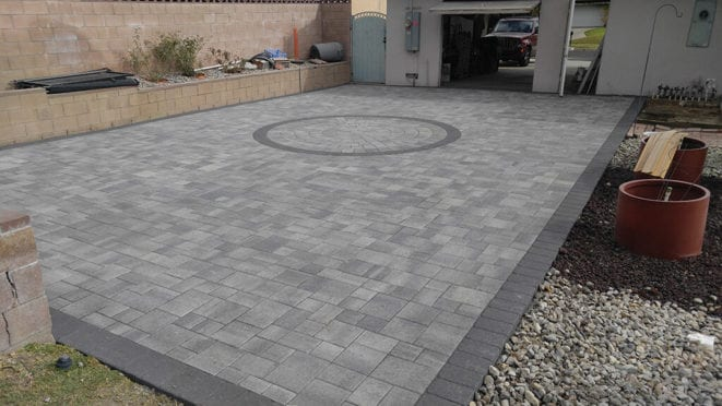Custom Gray Charcoal Patio with Circular Kit and Charcoal Border