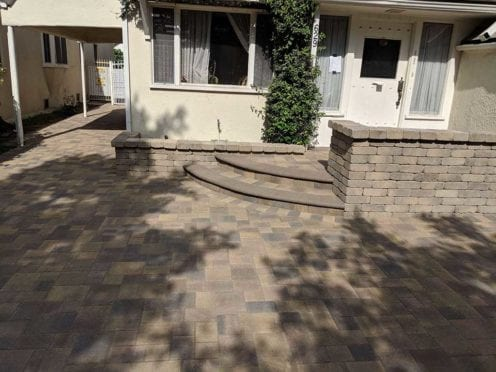 Sand-Stone-Mocha-with-Cream Brown Charcoal Courtyard Driveway with Steps and Rustic Wall