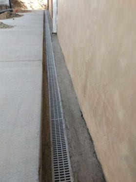 Drains: Long Channel Drains Next to the House Wall